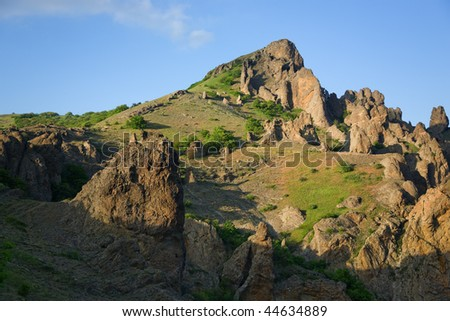 Picturesque rocks at top of mountain in Crimea in the evening