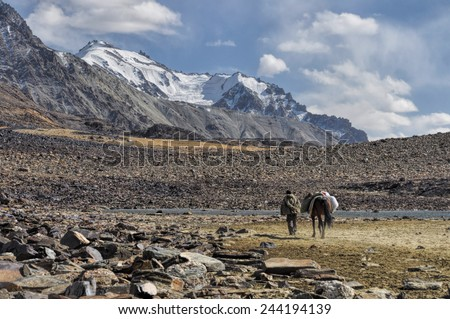 Picturesque rocky valley in Pamir mountains in Tajikistan - stock photo