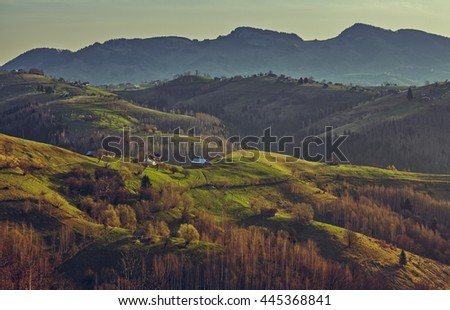 Picturesque rural landscape with early morning sunlight over the Rucar-Bran pass in Brasov county, Romania. - stock photo