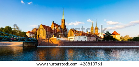 Picturesque scene of famous Tumski island with cathedral of St. John on Odra river. Colorful spring landscape in Wroclaw, Poland, Europe. Artistic style post processed photo.  - stock photo