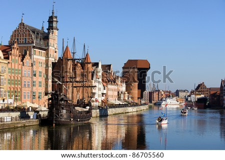 Picturesque scenery in the Old Town of Gdansk in Poland with Motlawa river and The Crane at the far end. - stock photo