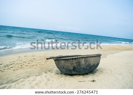 Picturesque sea landscape with tribal boat - stock photo