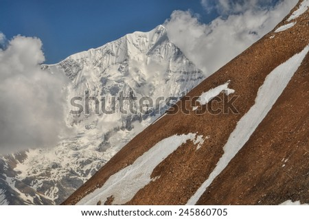 Picturesque steep slope in Himalayas mountains in Nepal - stock photo