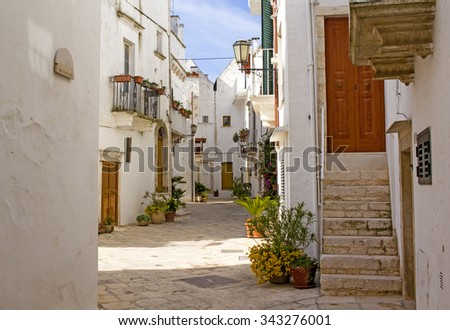 Picturesque street in the town of Locorotondo in Southern Italy.  - stock photo