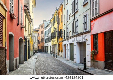 Picturesque street with colorful buildings in Parma, Emilia Romagna region, Italy.
