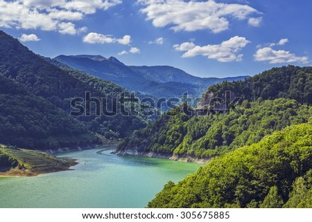 Picturesque summer landscape with clear mountain lake in the Siriului mountains, Buzau county, Romania. - stock photo
