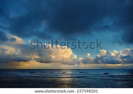 Picturesque sunrise at a tropical beach - stock photo