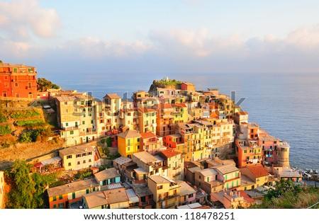 Picturesque sunset in colorful Manarola village (Cinque Terre, Italy) - stock photo