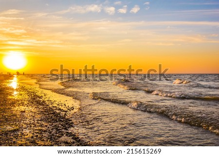 Picturesque sunset on the sea shore on a summer evening - stock photo