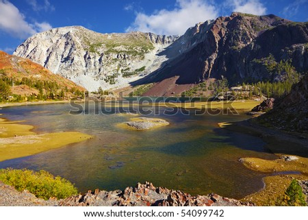 Picturesque superficial lake on pass Tioga in Yosemite park in the USA. Autumn midday - stock photo