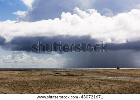 Picturesque thick clouds, beach landscape. Clouds over the beach in Santa Monica, United States. The ocean during strong winds.