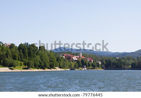 Picturesque touristic village Fuzine, Croatia, by the lake - stock photo