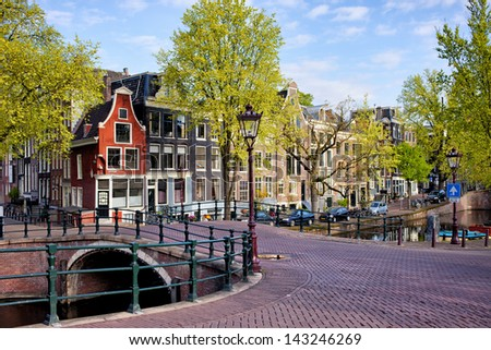 Picturesque traditional Dutch houses and bridge on the Reguliersgracht canal in Amsterdam, Holland, Netherlands. - stock photo