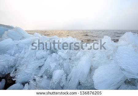 Picturesque twilight landscape of the Baltic sea with rubble ice in the foreground  - stock photo