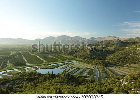 Picturesque valley on a background of mountains before dusk, Croatia. - stock photo