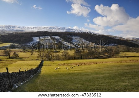 Picturesque valley with snow on hills - stock photo