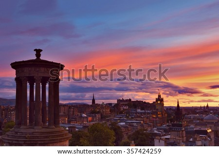 Picturesque view of evening Edinburgh old town at sunset with the Castle from Calton hill , Scotland, UK - stock photo