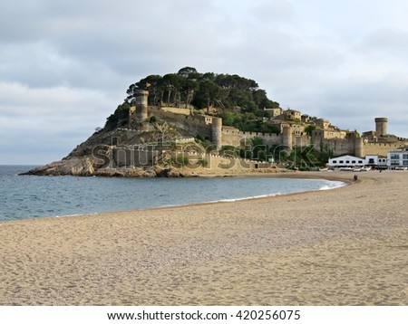 Picturesque view of Tossa de Mar beach and medieval fortress