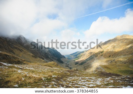 picturesque view on mountains and serpentinous road