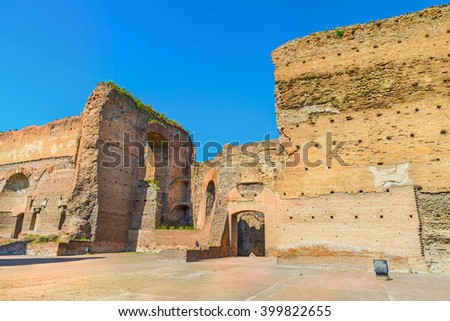 Picturesque view on ruins the ancient roman Baths of Caracalla ( Thermae Antoninianae ) at  sunny day.Huge baths built between AD 212 and 217. Beautiful architectural landscape. Rome. Italy. Europe.