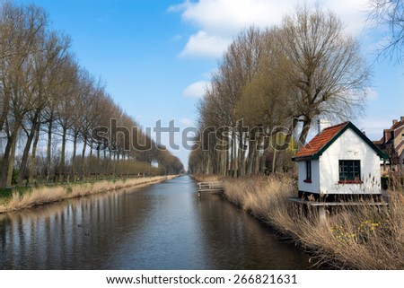 Picturesque view on the Damse Vaart canal in the village of Damme near Bruges in Belgium - stock photo