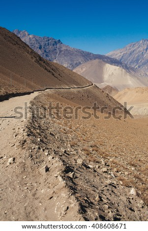 Picturesque view on the road to Annapurna mountain in Nepal. Deep blue sky. Mars landscape. Annapurna trekking path. - stock photo