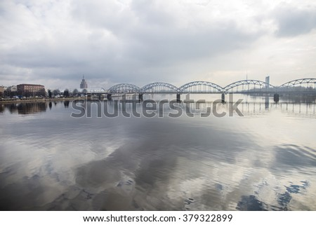 Picturesque view over the metal Railway Bridge over the Daugava river in Riga, Latvia