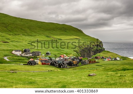 Picturesque village of Gjogv with typically colourful houses on the island of Eysturoy, Faroe Islands, Denmark - stock photo