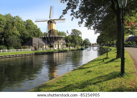 Picturesque windmill along the canal near Weesp, Holland. - stock photo