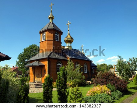 picturesque wooden Orthodox church in the village Kostomloty in eastern Poland on the border with Belarus