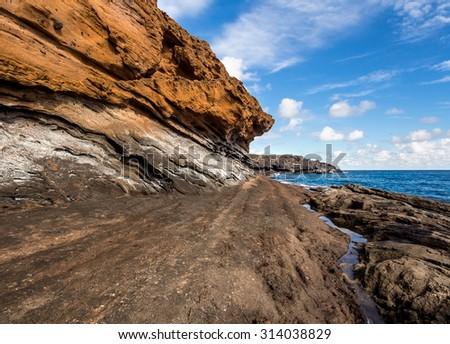 Picturesque Yellow Mountain (Montana Amarilla) in Costa del Silencio. Tenerife, Canary Islands - stock photo