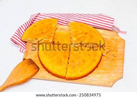 pie on a wooden board in the kitchen - stock photo