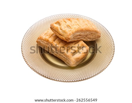 Pie puff pastry in a saucer isolated on white background - stock photo