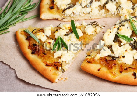Pie with feta cheese, onions and rosemary - stock photo