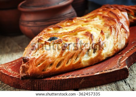 Pie with fish and egg, selective focus