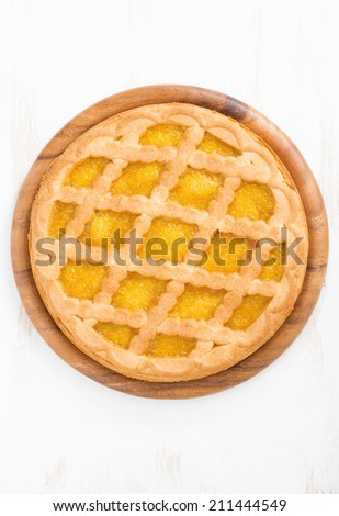 pie with fruit filling on a white wooden background, top view, vertical - stock photo