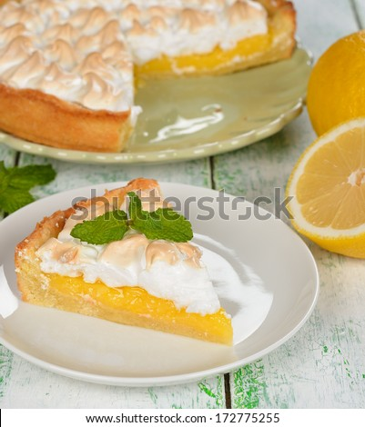 Pie with meringue on a white background closeup - stock photo