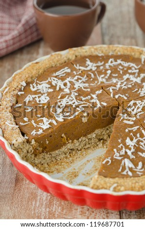 Pie with pumpkin and chocolate with a piece of cut