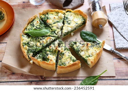 Pie with spinach and feta cheese, food - stock photo
