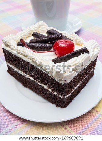 piece of a black forest chocolate cake. - stock photo