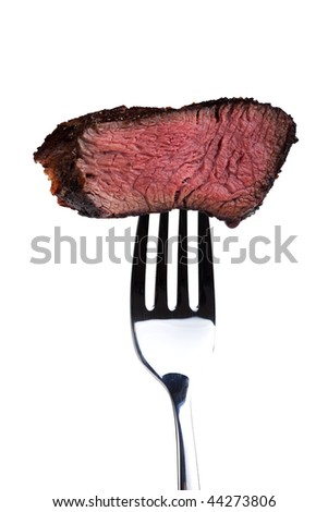 piece of a grilled steak on a fork - stock photo