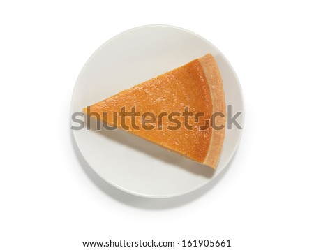 Piece of a pumpkin pie on a saucer isolated on white background with a clipping path  - stock photo