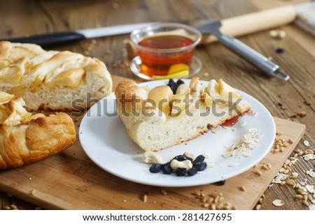 Piece of apple pie and lemon tea on the table - stock photo