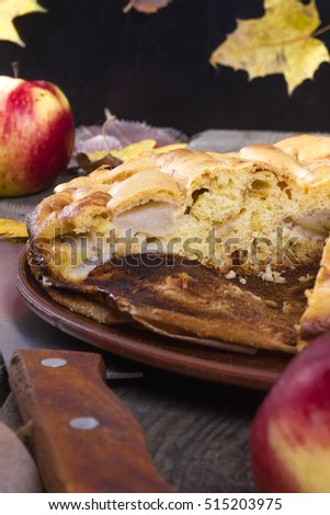 piece of apple pie on a wooden table in autumn style