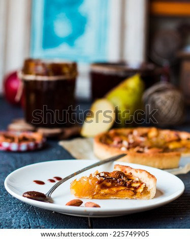 piece of apple tart on a round plate, spoon caramel, french dessert