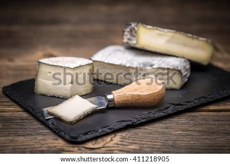 Piece of artisan brie cream cheese - stock photo