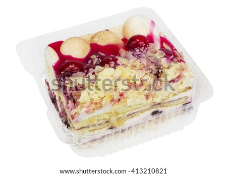 Piece of autumn  biscuit cake with cranberry berries  and butter cream in standard plastic container. Isolated with patch