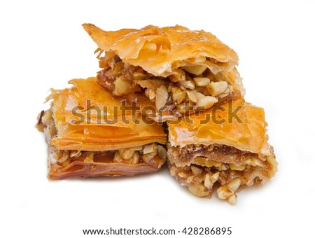 Piece of baklava sweets on white background