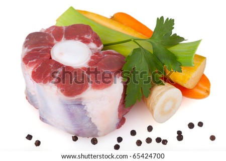 Piece of beef with root vegetables and peppercorns