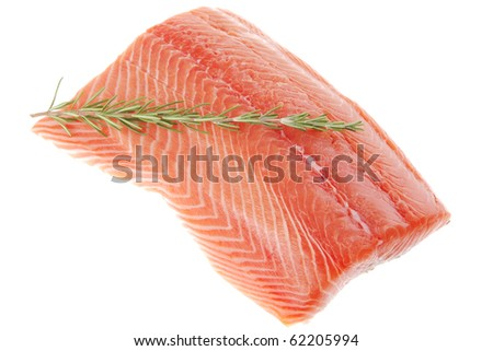 piece of big salmon fillet with rosemary over white